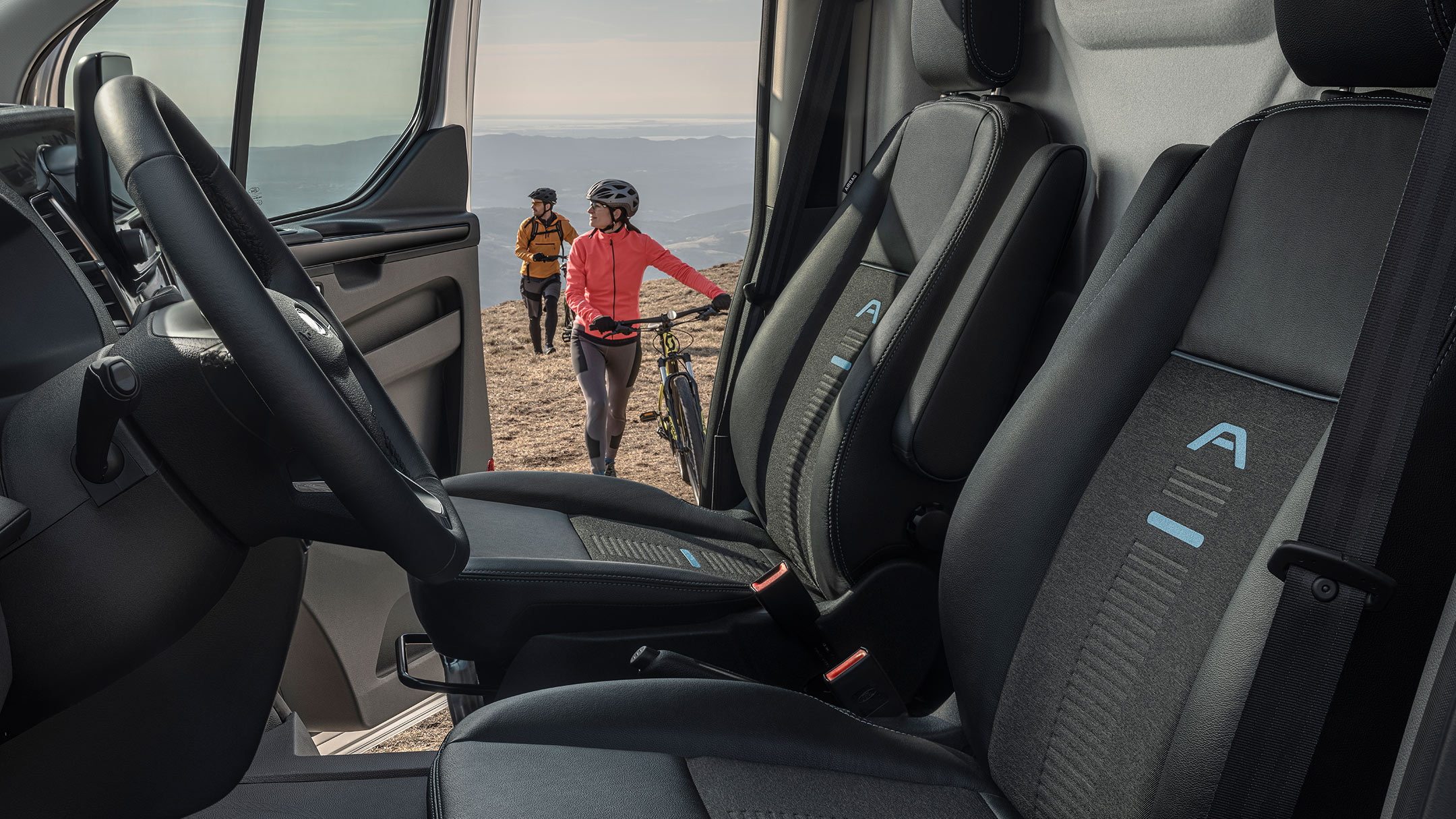 Ford Transit Custom Active inside view with door open and two cyclists walking